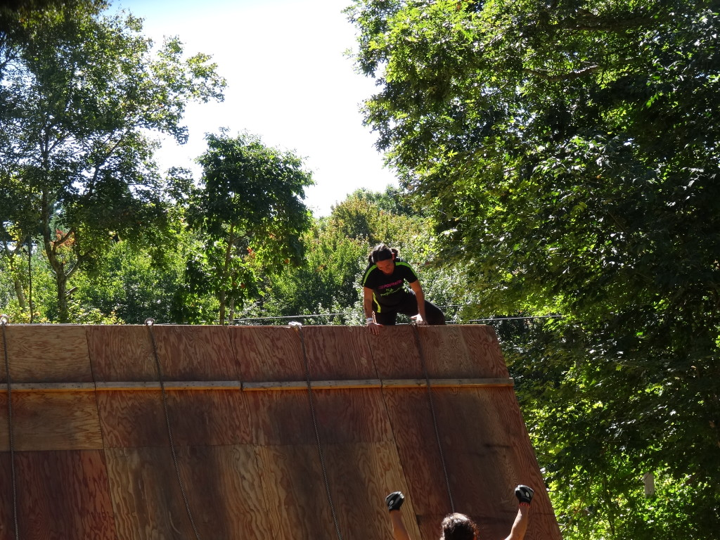 Climbing over a 15 foot wall at BoldrDash.