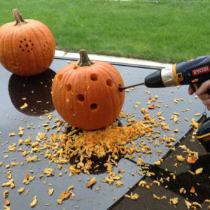 pumpkin-carving-with-power-drill-halloween-decorations-seasonal-holiday-decor-tools